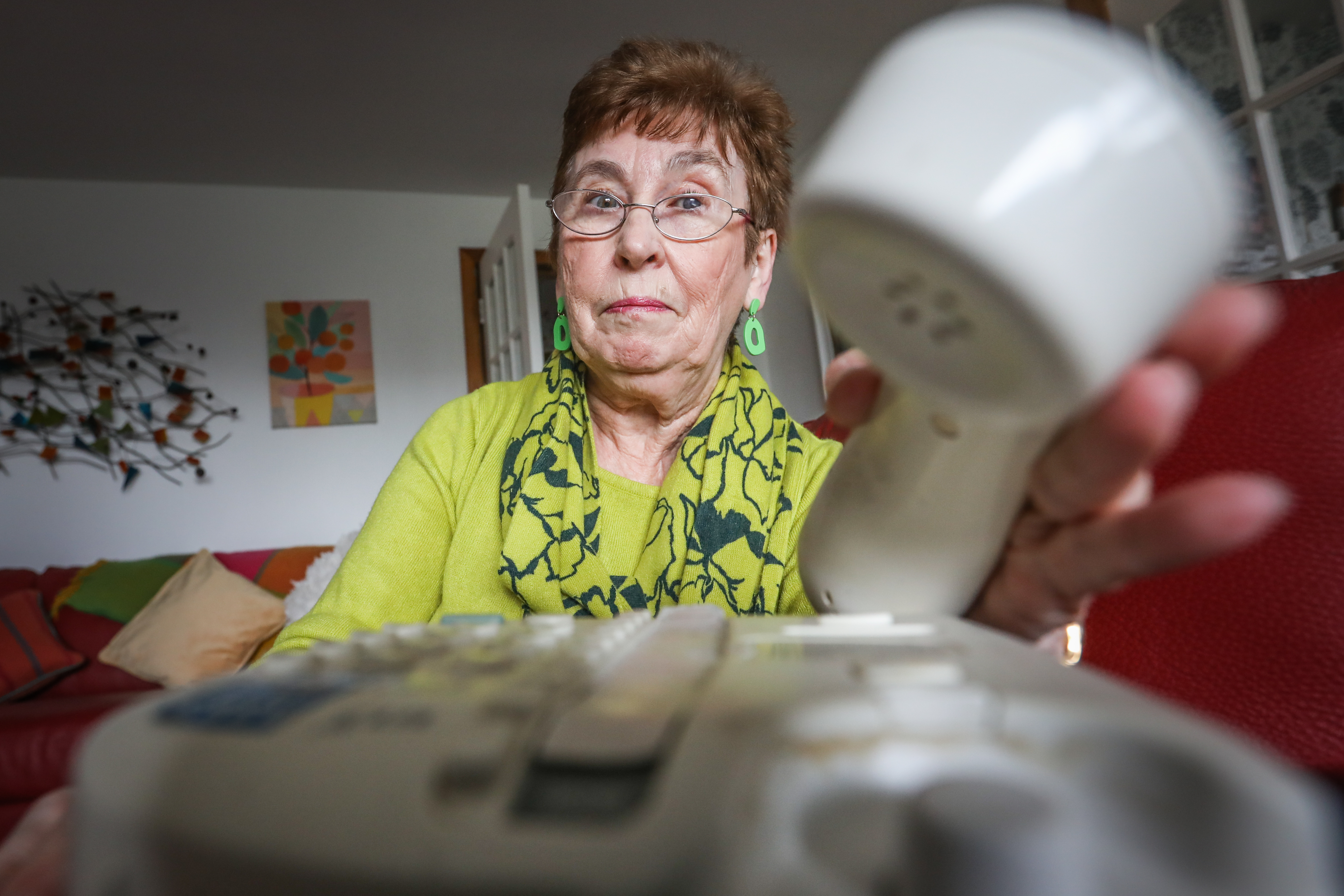 Winnie Flynn at home with her landline phone.