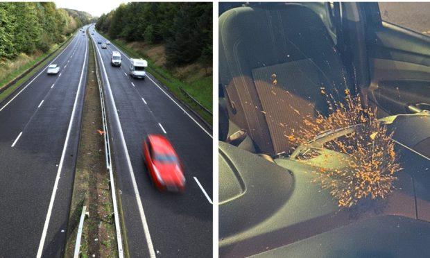 A 'mud missile' was launched at a vehicle from a bridge over the A92.
