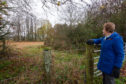 Jean Brymer shows where the cows were buried.