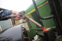 Filling a tractor with red diesel... but reported issues include poor performance, blocked filters and injector failure.
