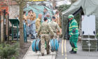 Military and emergency services personnel outside Bourne Hill police station in Salisbury, as police and members of the armed forces probe the suspected nerve agent attack on Russian double agent Sergei Skripal.