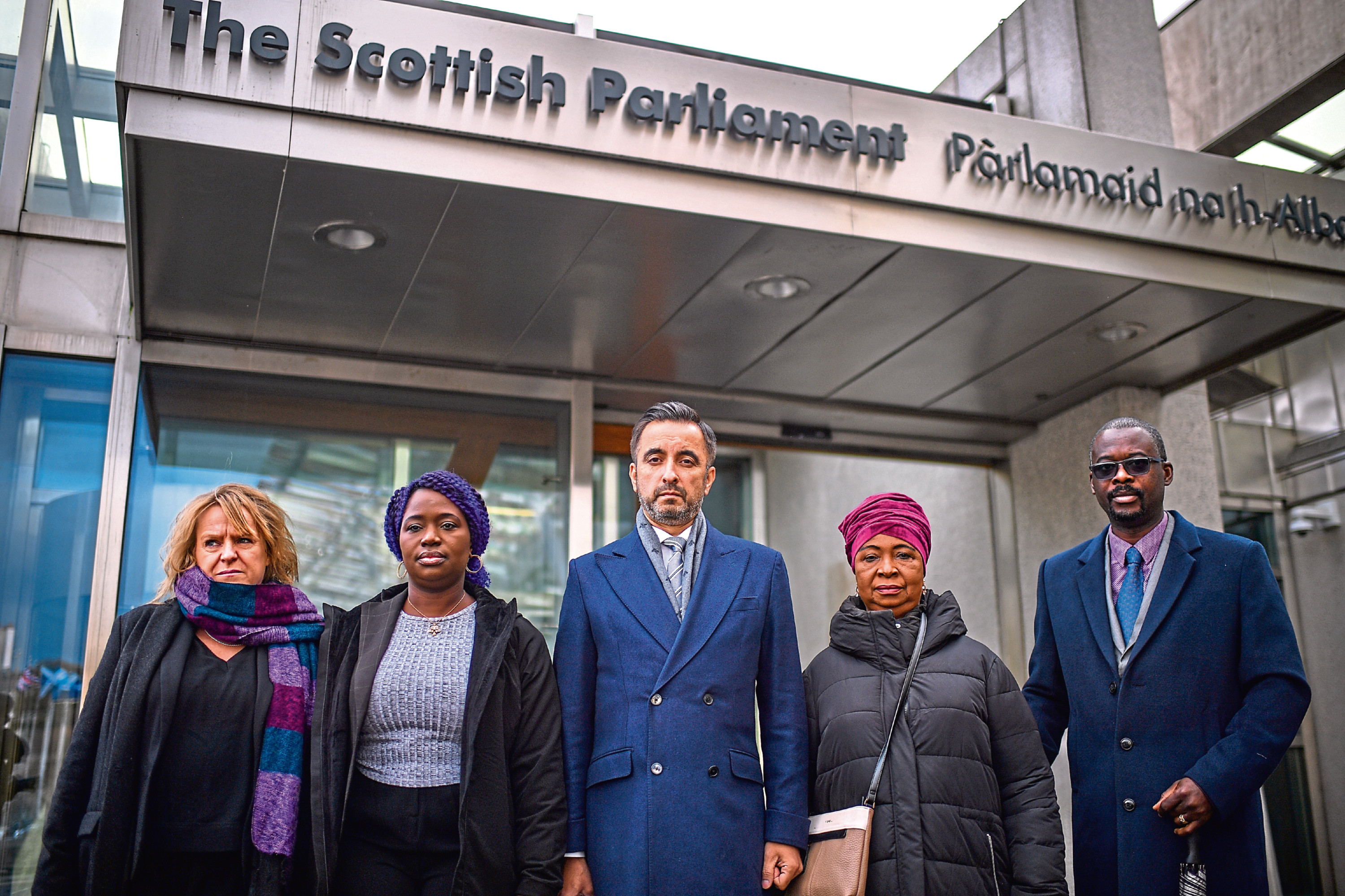 The mother of Sheku Bayoh, Aminata Bayoh (2ndR) brother in law Adey Emi Johnson, his sister Adama Kadijartu Johnson Lawyer Aamer Anwar and Debrah Cole director of inquest arrive at the Scottish Parliament for a meeting with First Minister Nicola Sturgeon and Justice Secretary Humza Yousaf .