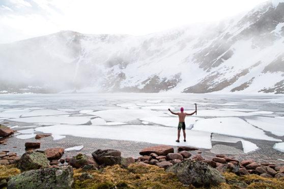 Calum MacLean prepares to swim in ice in Scotland's highest loch.