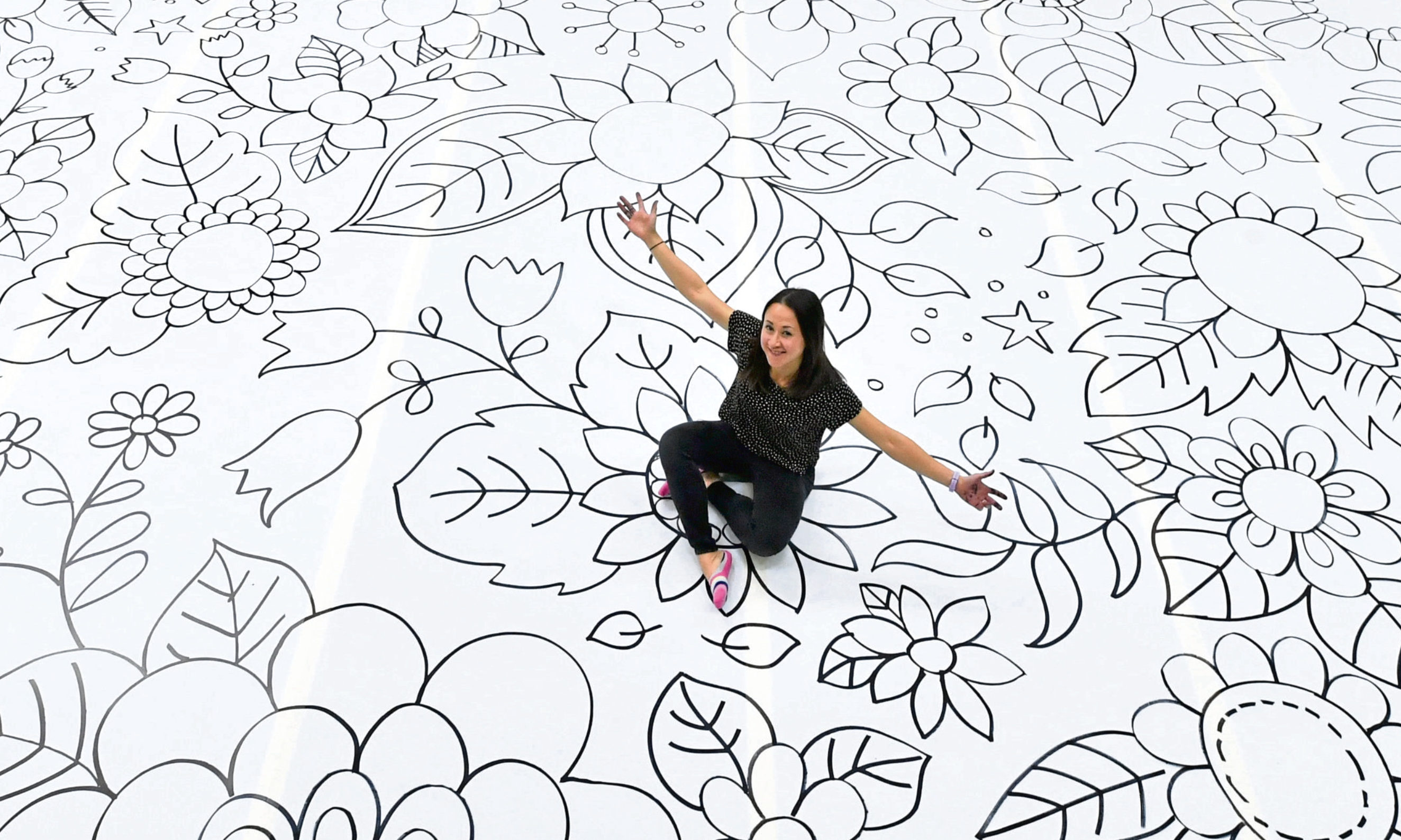 Bestselling illustrator Johanna Basford OBE with the mammoth floral artwork.