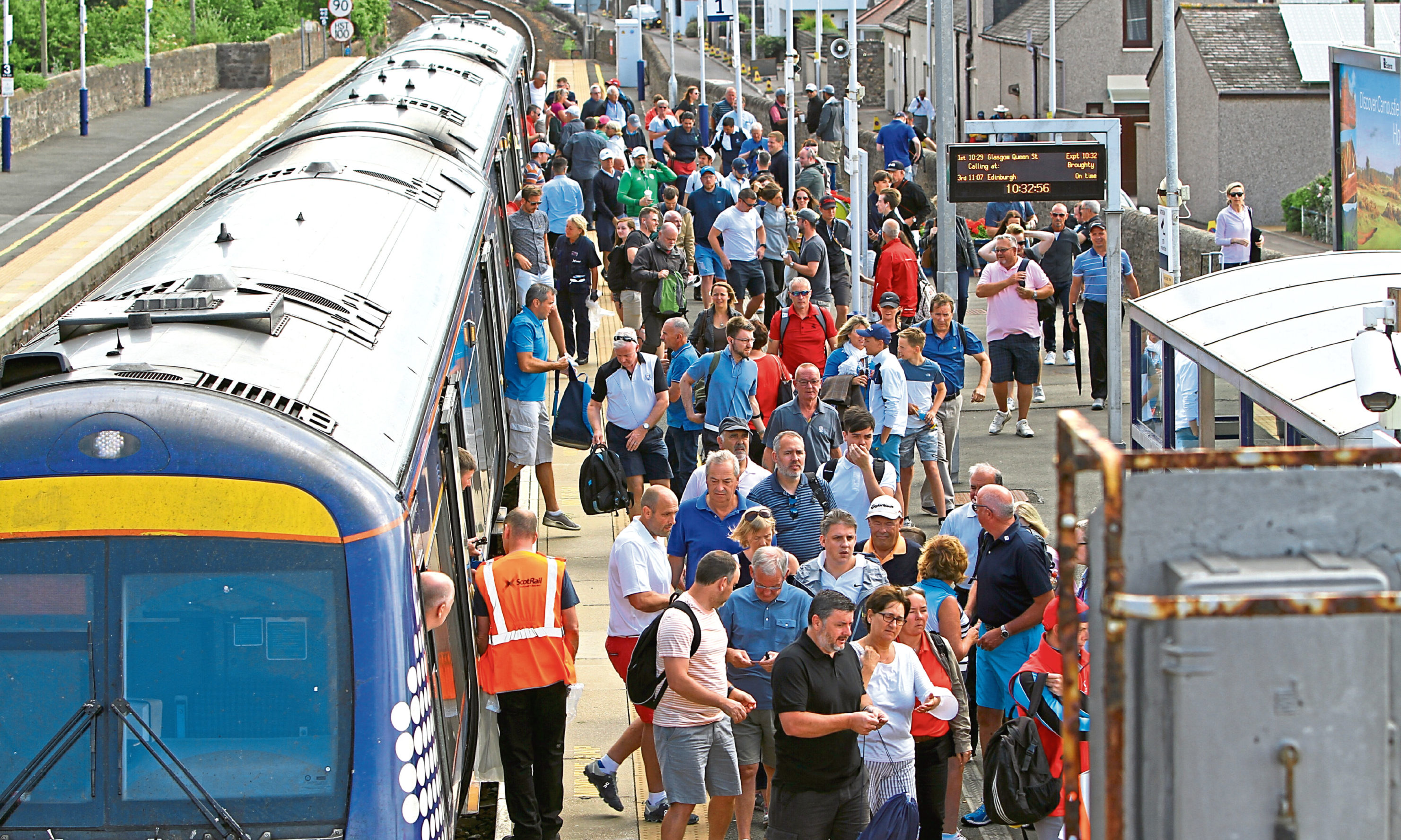Passengers disembarking at Carnoustie Station for the final round of the Open Golf Championship in 2018.