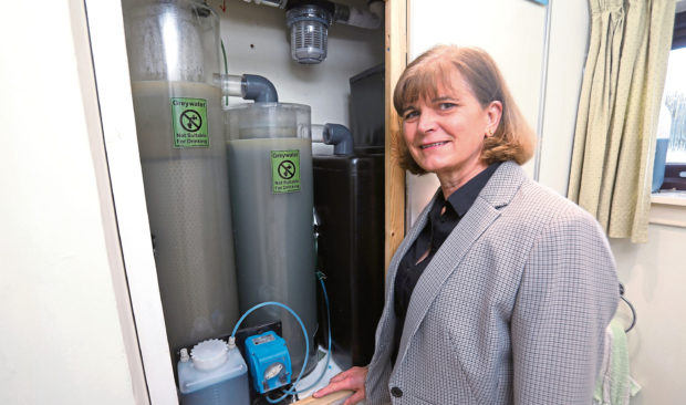 Cascade Water Products managing director Carolyn Hogg with the Aqua Gratis system. Picture: Dougie Nicolson.