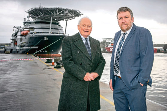 Montrose Port Authoritys outgoing chairman John Carmichael and chief executive Captain Tom Hutchison.