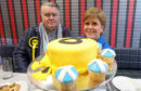 First Minister Nicola Sturgeon with Ochil & South Perthshire candidate John Nicolson during a visit to a bakery whilst on the election campaign trail in Alloa.