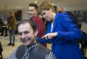 Nicola Sturgeon gives her party's candidate for North East Fife Stephen Gethins a haircut, during a visit to Craig Boyd Hairdressing in Leven, Fife.