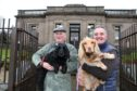 Councillor Craig Duncan with Ria and Alessandro Palladino with Flo outside Broughty Ferry library