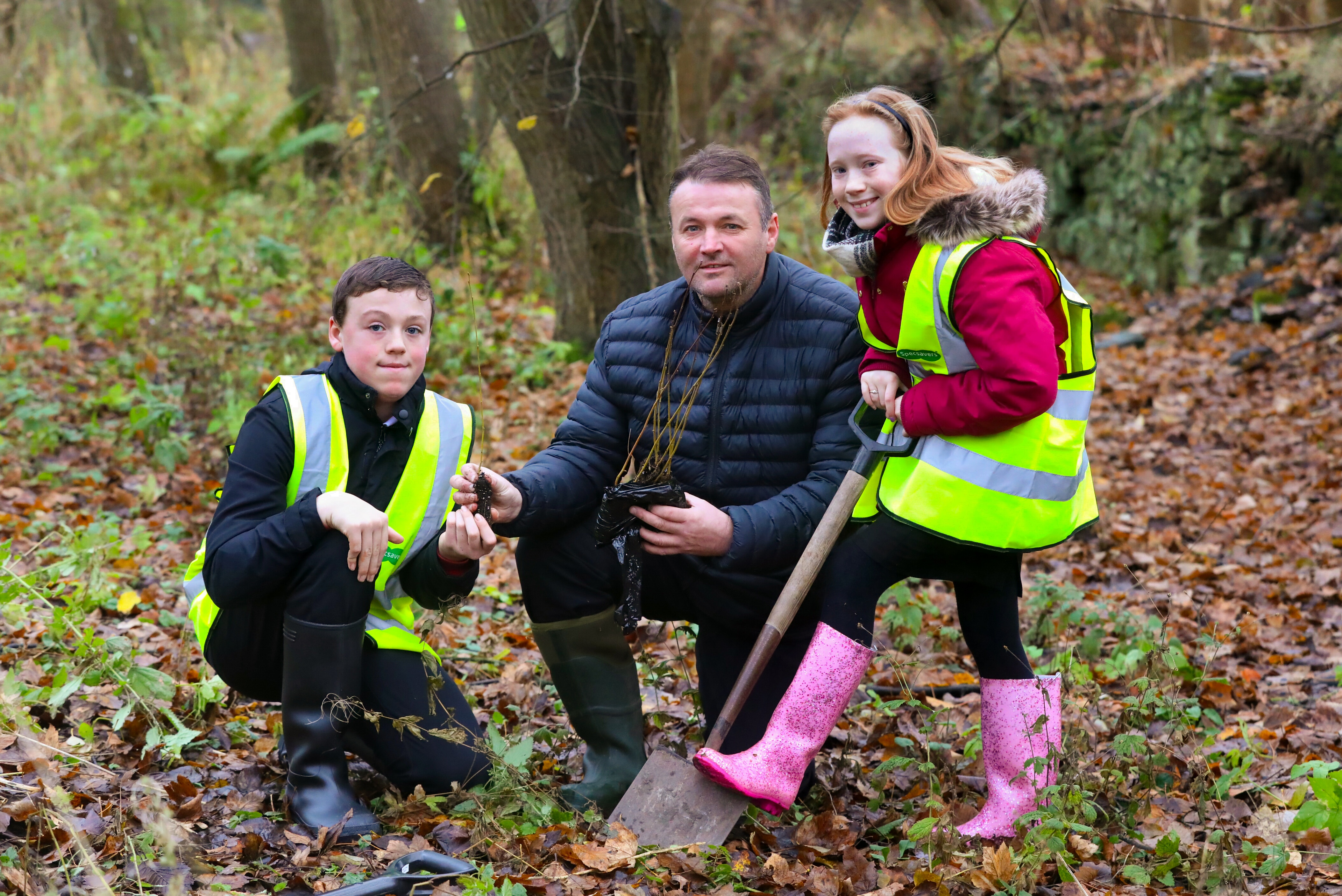 """Ralf Coutts of the """"St Vigeans Conservation Network"""" gets some help from Nathan McCormack and Norijane Forbes (both 11) from Warddykes primary school, to plant some young trees in part of the Millenium Forrest at St Vigeans."""