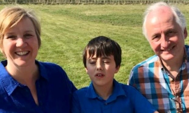 Dylan, 12, with parents Jane and Colin Carmichael