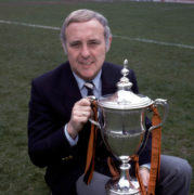 Jim McLean sits proudly with the Scottish Premier Division trophy, which his United side won in 1983.