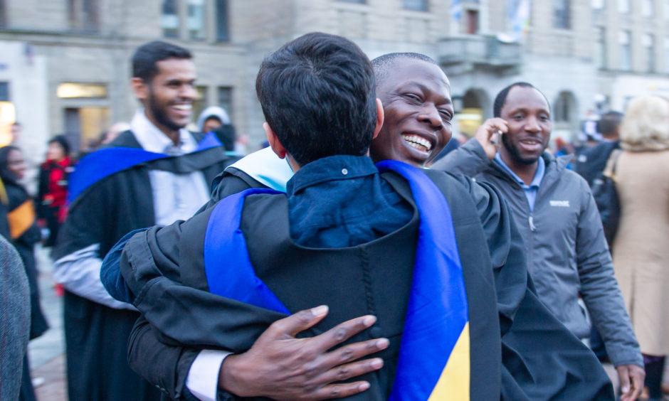A celebratory hug.