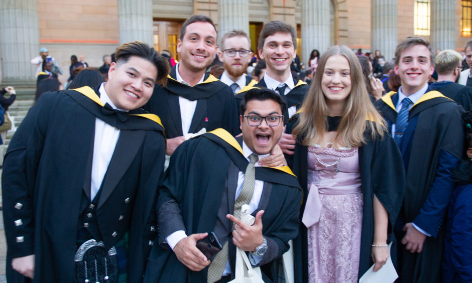 A group of graduates delighted with their achievements.