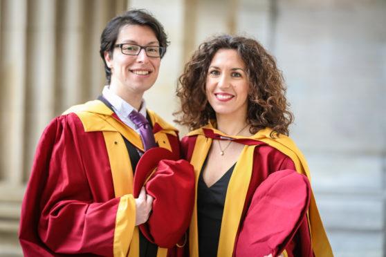 PHD graduates, Orion Mavridou and Konstantina Tsikrika outside the Caird Hall ahead of Abertay University's graduation ceremony.