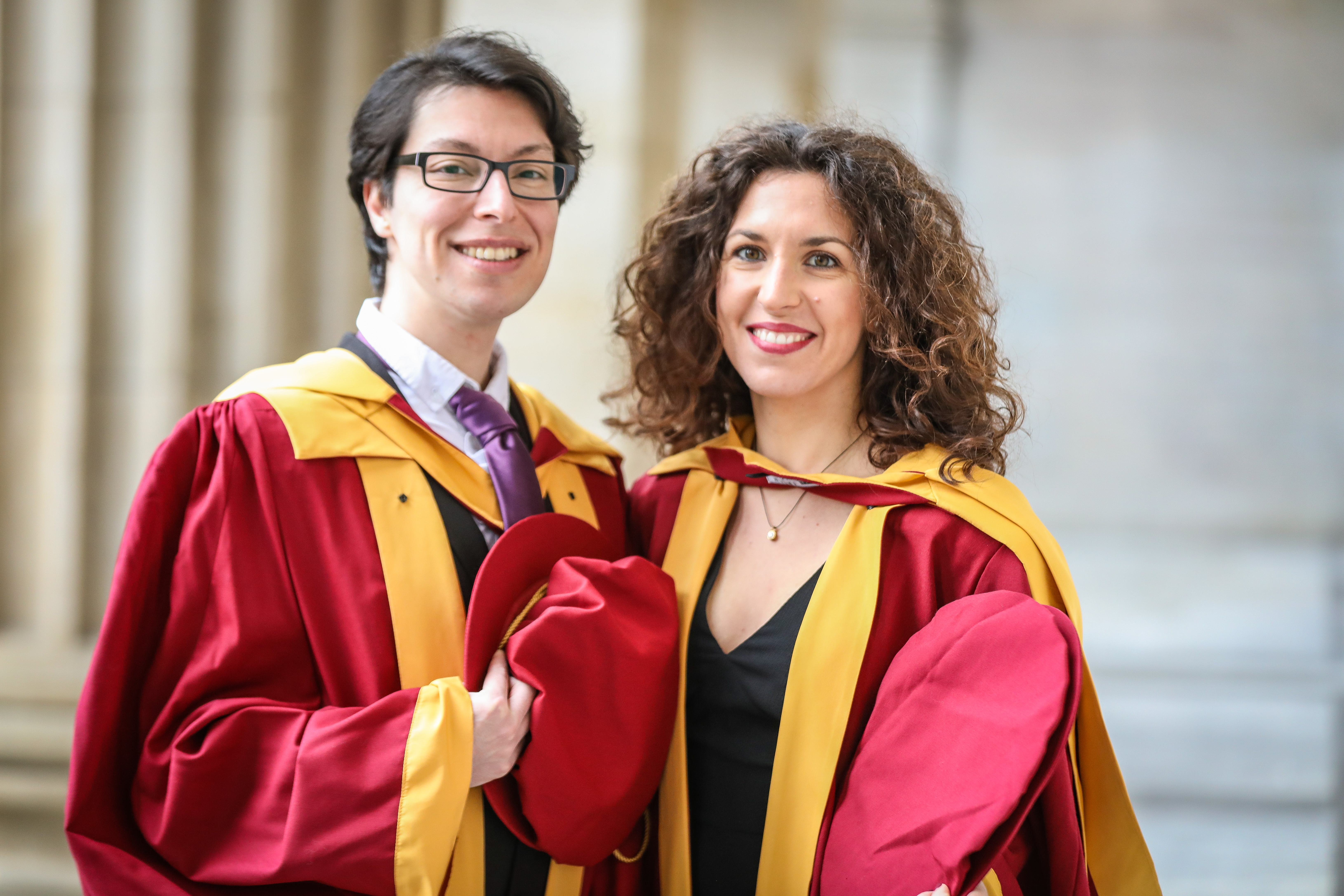 PHD graduates, Orion Mavridou and Konstantina Tsikrika outside the Caird Hall ahead of Abertay University's graduation ceremony.