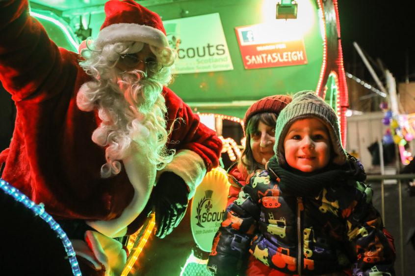 Sam MacDonald meeting Santa.