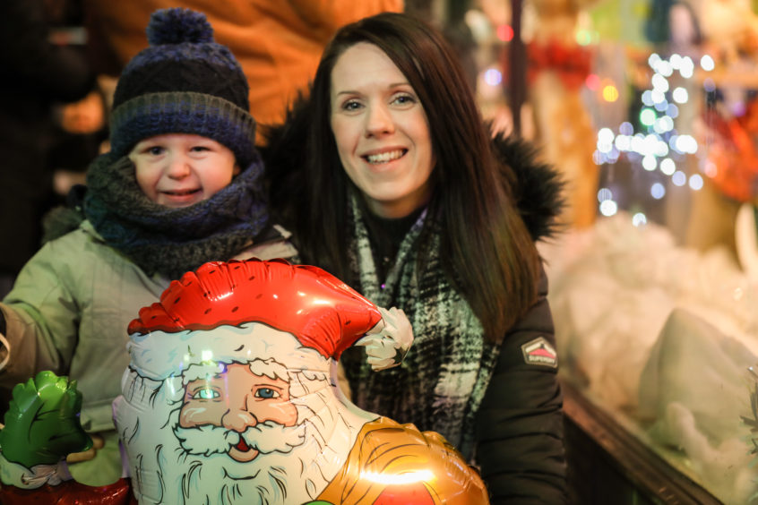 Cole and Ashley Valentine enjoying the Gillies display at the Christmas light switch on.