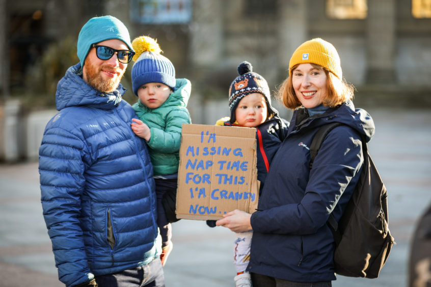 Steve and Joe Crawford with Charlie and Rachel Simpson taking part in climate strike protests.