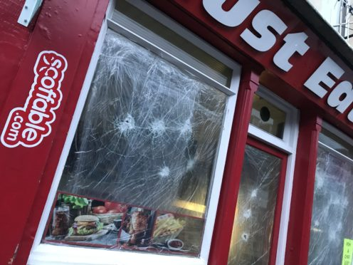 The Must Eat premises in the aftermath of the attack.