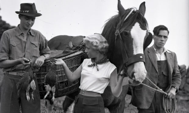 Prince Carlos with beater Fiona Cowans, Aberfeldy, in 1955