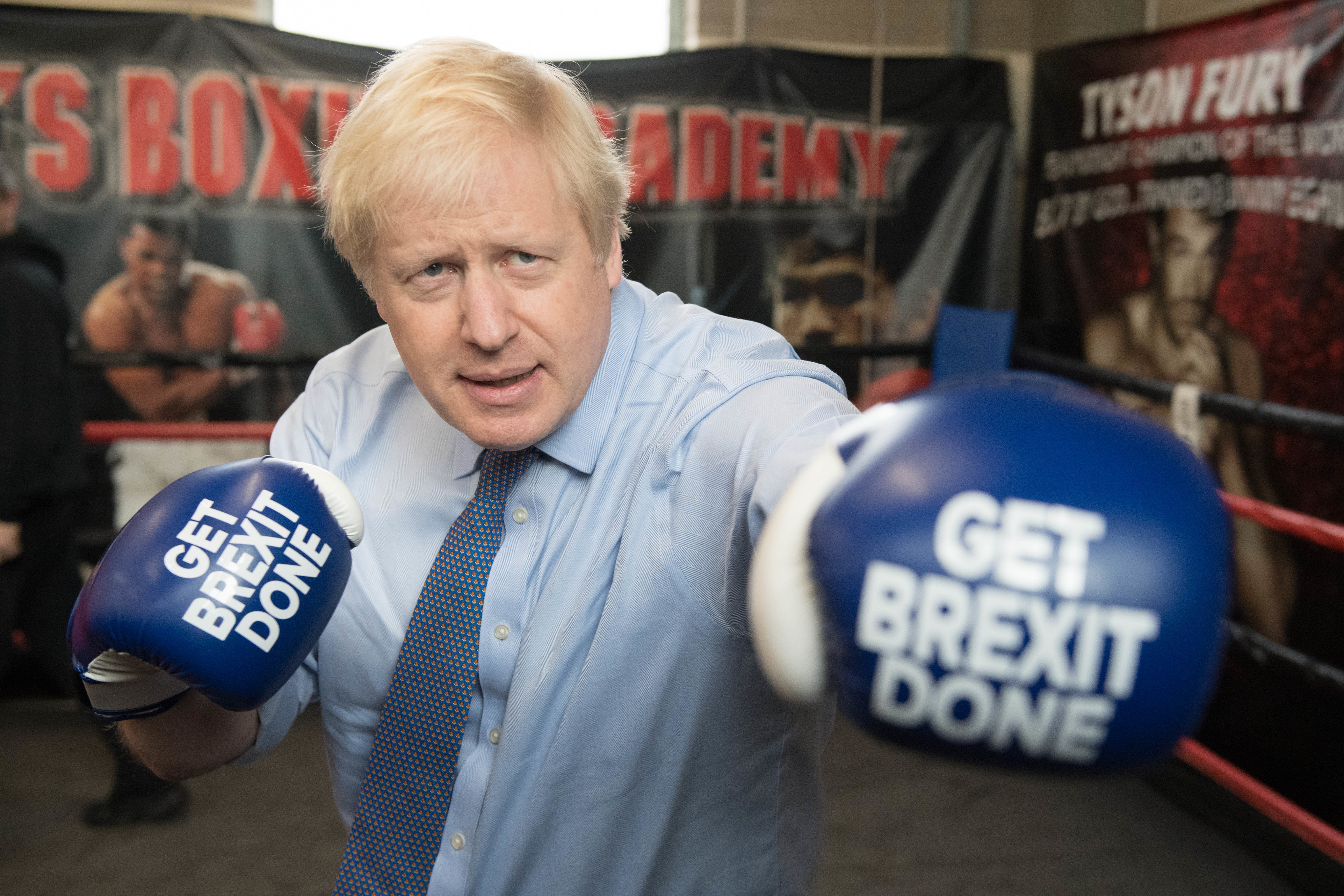 Prime Minister Boris Johnson during a visit to Jimmy Egan's Boxing Academy at Wythenshawe, while on the campaign trail.