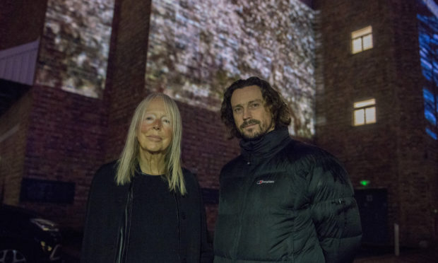 Artists Elizabeth Ogilvie and Rob Page with the projected art work.