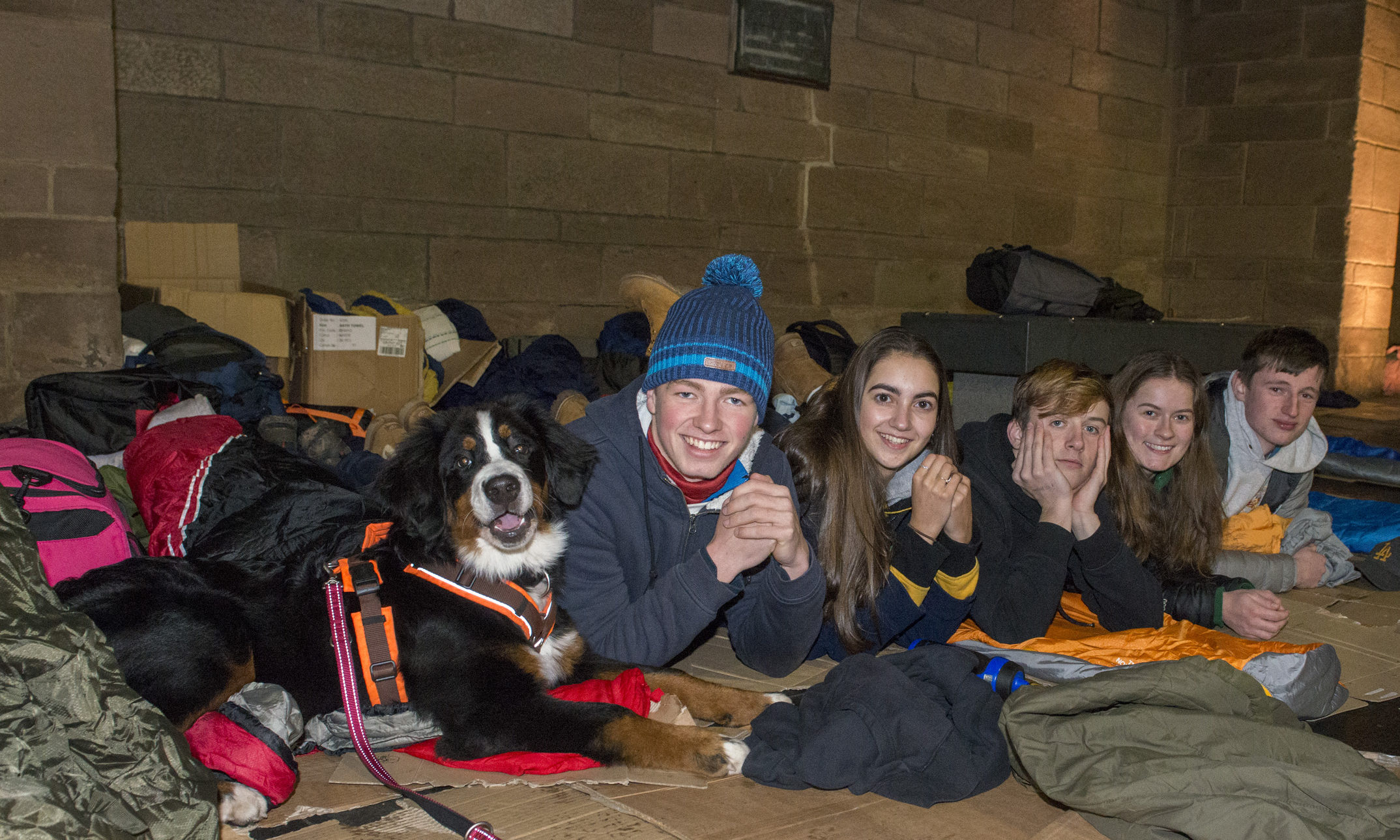 Students from Strathallan brave the elements with Burmese mountain dog Ella.