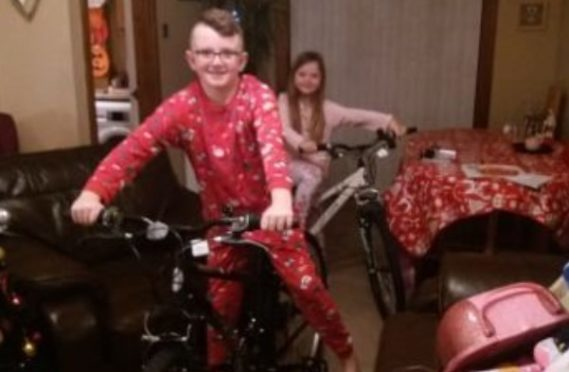 Rhys with his bike, just after unwrapping it last Christmas.