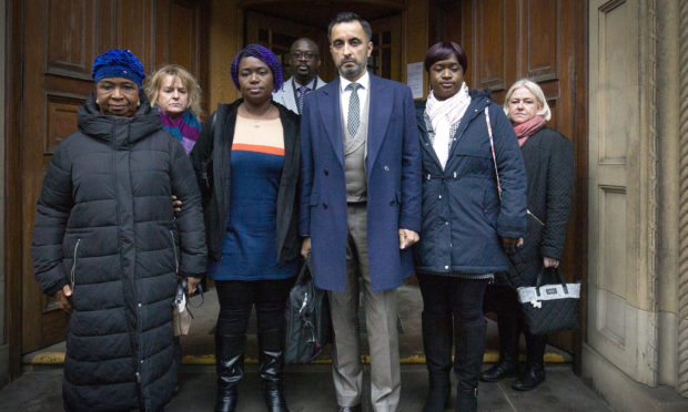 Solicitor Aamer Anwar (centre) arrives at the Crown Office in Edinburgh, with family members of the late Sheku Bayoh in November 2019.