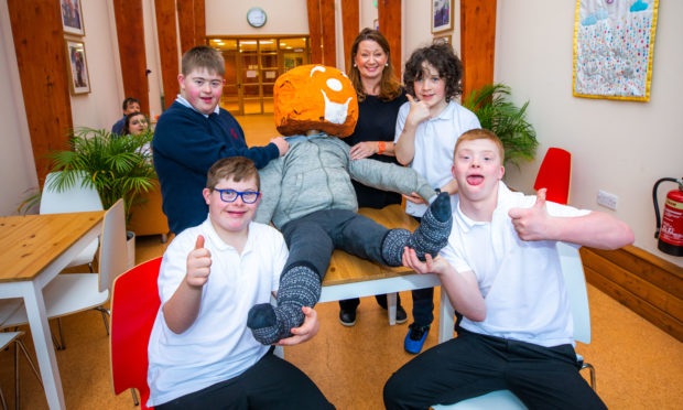 Pupils Aaron Ferguson, James Dickson (back), Aaron Duncan and Kevin Gardiner (front) and ASN teacher Tracey Lindsay at Fairview School have finished their Guy for the Perth bonfire.