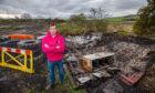 David Paton at the destroyed huts in November.