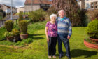 Picture shows Stephen Murray and wife Amy Murray (aka Mary Murray) in their garden; the area behind them is constantly marshy and saturated.