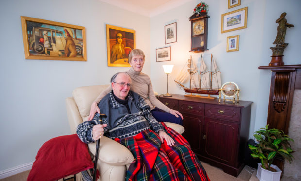 Cruise ship speaker Roger Cartwright is recovering in his home with wife June following a stroke on a flight midway across the Atlantic Ocean.