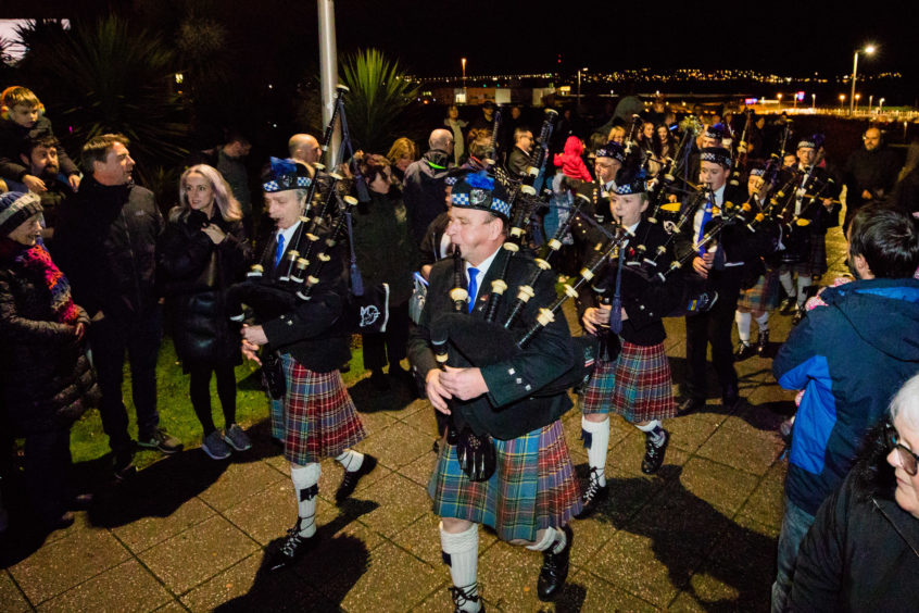Fintry Pipe Band lead the crowds to the Christmas tree.