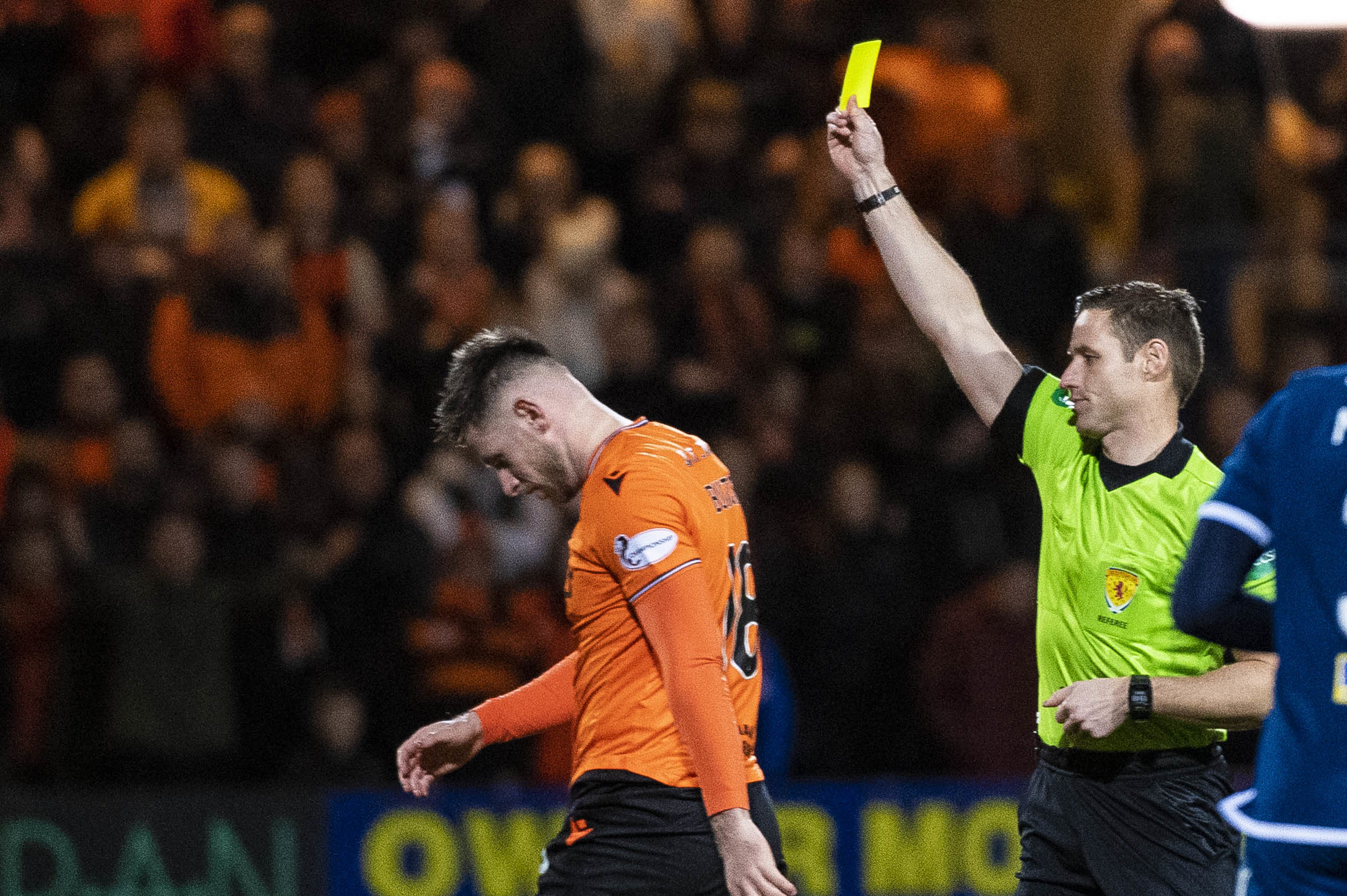 Calum Butcher is shown the yellow card for his challenge on Shaun Byrne.