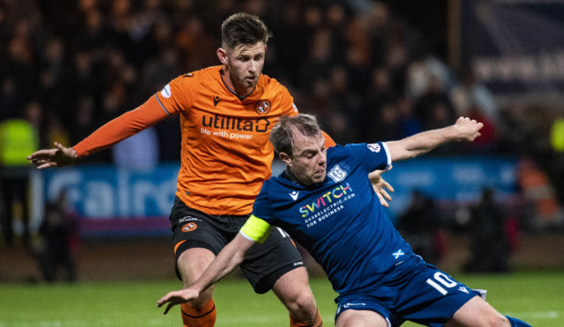 Calum Butcher in action against Paul McGowan of Dundee.
