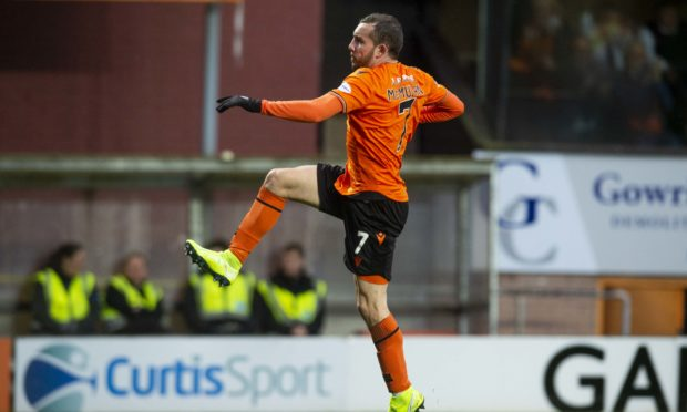Paul McMullan takes to the air to celebrate his opening goal.