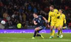 John McGinn makes it 3-1 during the UEFA European Championship Qualifier between Scotland and Kazakhstan at Hampden Park.