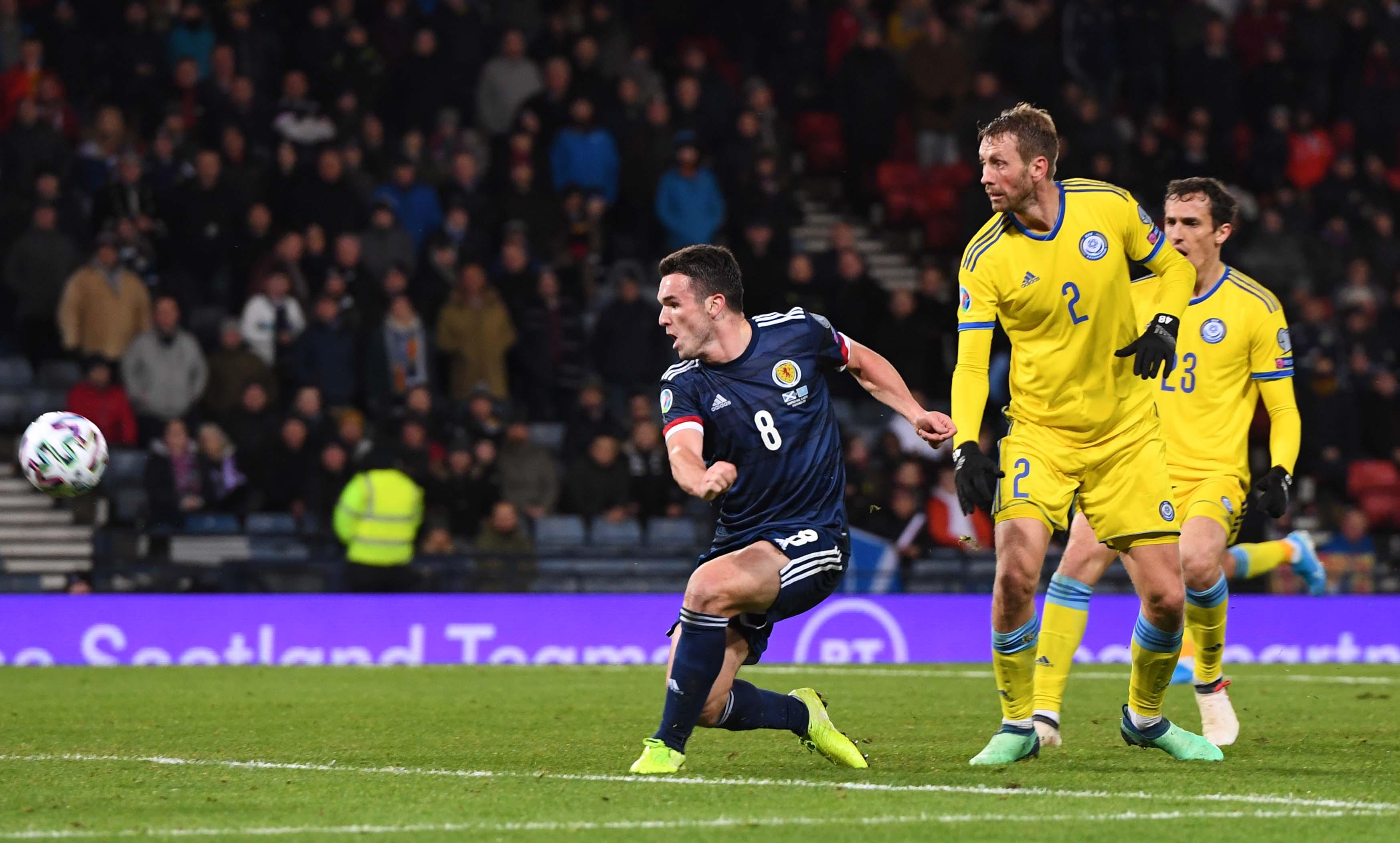 John McGinn makes it 3-1 during the UEFA European Championship Qualifier between Scotland and Kazakhstan at Hampden Park.