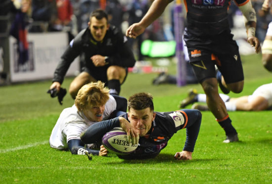 Blair Kinghorn scores the first half try for Edinburgh.