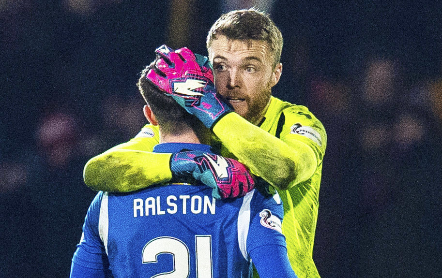 Zander Clark hugs Anthony Ralston at the full-time whistle.