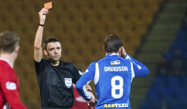 Ref Kevin Clancy shows Murray Davidson the red card.