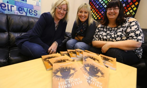L/R, Janet Henderson, Jackie Shand and Fiona Dewar with copies of the book Her Story Rewritten