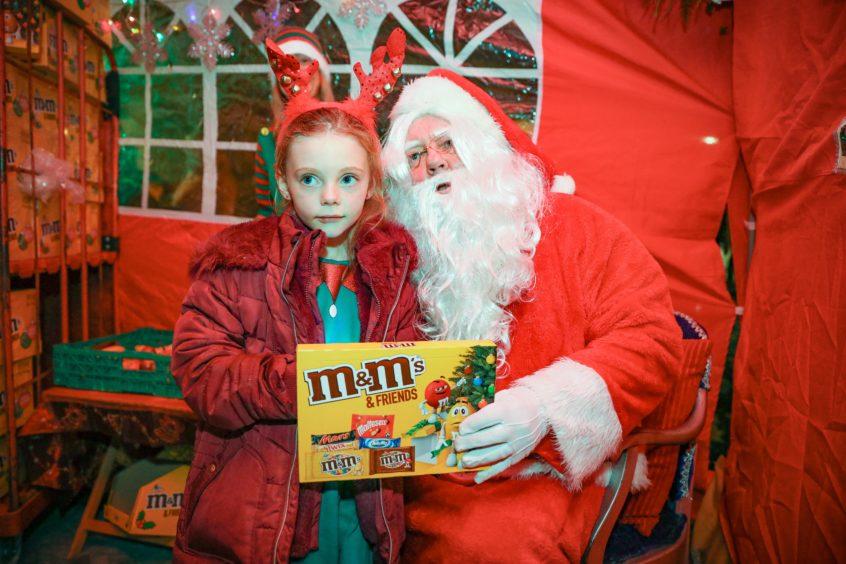 Elsie Carmichael meets Santa in Carnoustie.