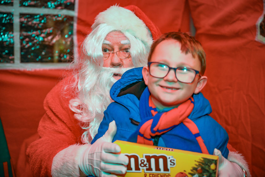 Kenzie Ferguson meets Santa in the Grotto at Carnoustie.