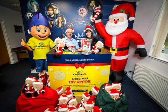 Craig Sneddon from Cowdenbeath in the toy box with Vanessa Motion as the launch of the Christmas Toy Appeal begins