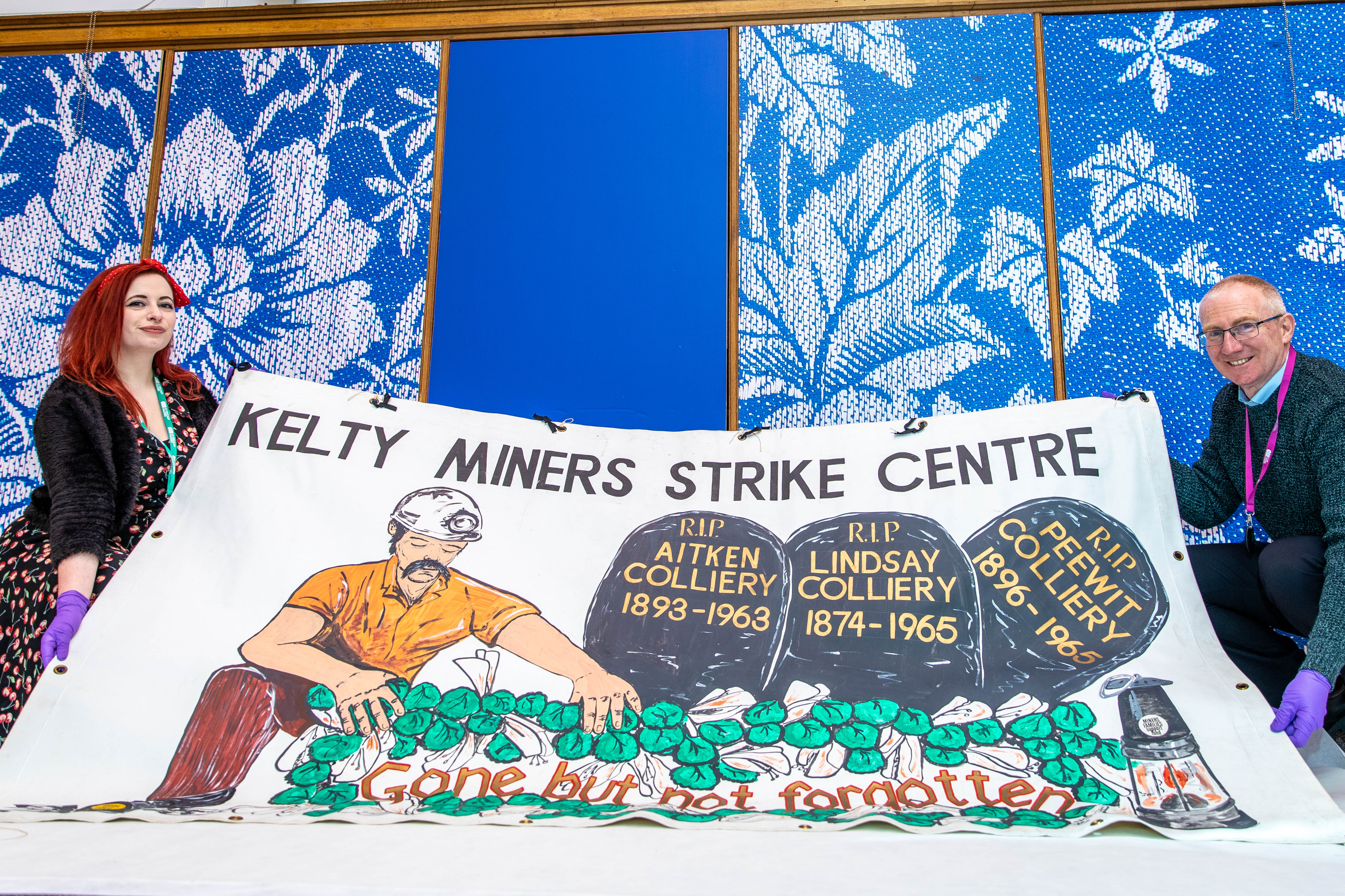 Curators Nicola Wilson and Gavin Grant with one of the mining strike banners ahead of Saturday's conference.