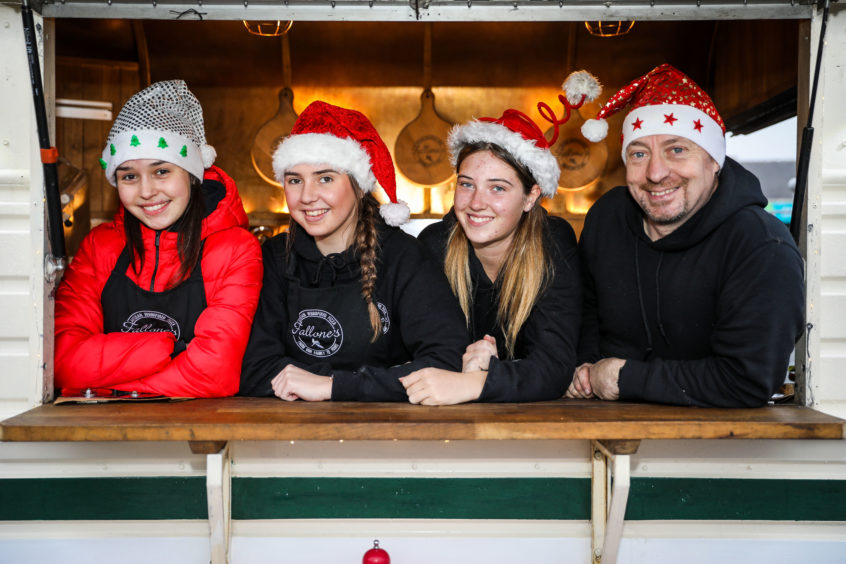 Lauren Worrell, Molly Stark, Emily Keith and Mike Fallone from Fallones Pizza in the festive spirit at Monifieth.